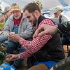 Jace Marti (center) passes out beer, the first tapped keg of Fest beer for the celebration, to members of the Hobo Band while Kyle Marti (out of frame) waited for more beer from his brother to pass out to a line of waiting people inside the main tent at Octoberfest. Photo by Jackson Forderer