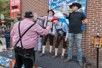 Scott Hislop, the facilitator of the stein holding competition at Octoberfest, grabs John Kelly's stein as Kelly bowed out of the competition. Trophies were given out to the top male and female winners of the strength and endurance competition. Photo by Jackson Forderer
