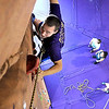 Dan Hawley makes his way up Minnesota State University's new indoor climbing wall Wednesday at Myers Field House.