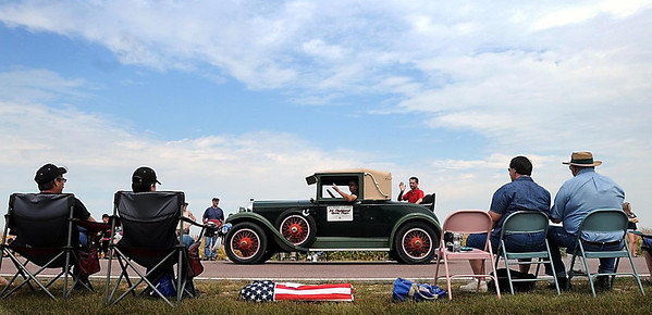 Spectators admire an antique car as it creeps along Brown County Highway 6 leading into Godahl Monday during that tiny community's annual Labor Day celebration and parade.