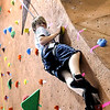Minnesota State University student Blaine Henkel looks for his next foothold while climbing the new indoor climbing wall at Myers Field House.