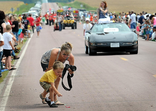 Spectators and cars stretch far down the county roads leading into Godahl, Minn., whose population according the last census stood at 21. That number swells to over a thousand every Labor Day when the Brown County crossroad's population swells to over a thousand for their annual celebration.