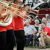 Spectators watch the St. James High School band as it marches through Godahl Monday during the tiny community's annual Labor Day celebration.
