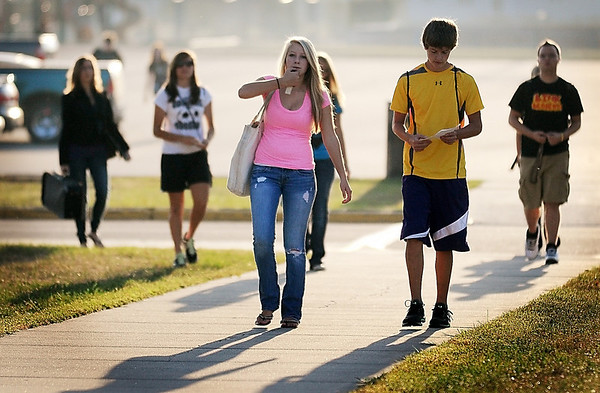 Students at East High School head for their first day of classes Tuesday. Middle school and grade school classes in Mankato Area Public Schools begin on Thursday.