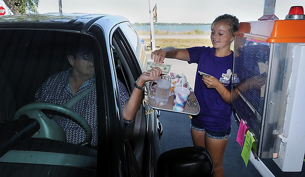 Traffic is light on old Highway 14 along Clear Lake as car hop Olivia Mcintosh serves a customer at Barney's Drive-In on the east side of Waseca.