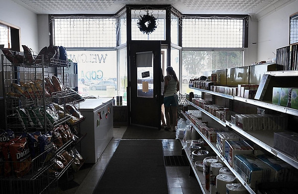 Customers leaeve the Albin & Nelson Cooperative, a general store which under various owners has been in operation at the crossroads of Brown County Highways 6 and 10 where Godahl is located since 1894.