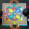 Monks from the Drepung Loseling Monastery work on a mandala sand painting Wednesday afternoon at MSU's Centennial Student Union. The monks will work eight hours a day until Friday to create the work, which will then be destroyed to symbolize the impermanence of life.