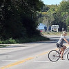 Traffic is light as campers at Kiesler's Camground ride their bikes across the old Highway 14 route on the east side of Waseca.