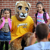 John Cross<br /> Kindergarteners Aaliya Fliescher (left) and Laynee Johnson pose for photos with the mascot of Kennedy Elementary School on the first day of classes on Thursday.