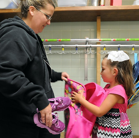 John Cross<br /> Brooke Flowers and mother, Kelly Reinke, unpack her backpack in her kindergarten classroom at Kennedy Elementary School on Thursday, the first day of classes.