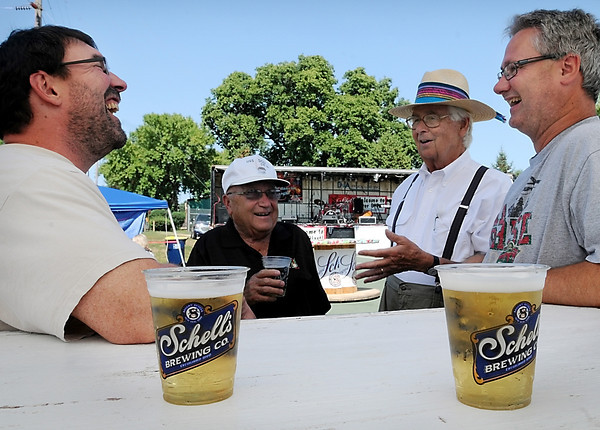John Cross<br /> From left, Tom Wheeler, Denny Warta, George Glotzback and Brian Filzen enjoy a laugh and a cold one at Riverblast in New Ulm on Saturday.