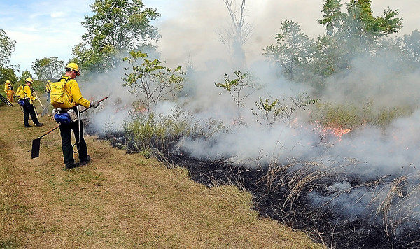 John Cross<br /> Burn crews from the Minnesota Department of Natural Resources monitor a prescribed burn that was done to of a portion of Minneopa State Park on Tuesday.