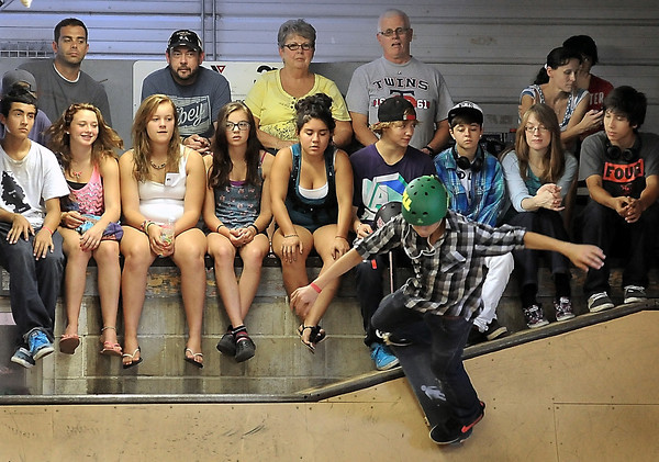John Cross<br /> Spectators have a ringside seat to watch competitors show their skateboarding skills off during a skateboard competion at Chesley Skate Park on Saturday.