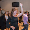 Salsa dance instructor Jessica Roemhildt demonstrates how to do a turn at the third class of salsa at Burrito Express. The popularity of the class has grown so much so that Roemhildt is offering two classes on Friday at 7 and 8 p.m. Photo by Jackson Forderer