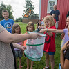Becky Pollack, left, opens a holding net to release monarch butterflies that were tagged by Pollack and young helpers at the Ney Nature Center in rural Henderson. The center can't begin to tag monarchs until the end of August, when the fourth generation of monarchs are alive that winter in Mexico. Photo by Jackson Forderer