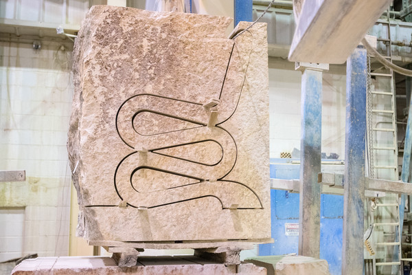 A profile view of a stone bench cut out of a larger block at Vetter Stone in rural Mankato. Photo by Jackson Forderer
