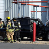 Firefighters carry a plant worker pretending to be injured in a truck accident during a drill Saturday at the Guardian Energy ethanol plant in Janesville. Firefighters and plant workers simulated an accident and chemical spill during the drill.