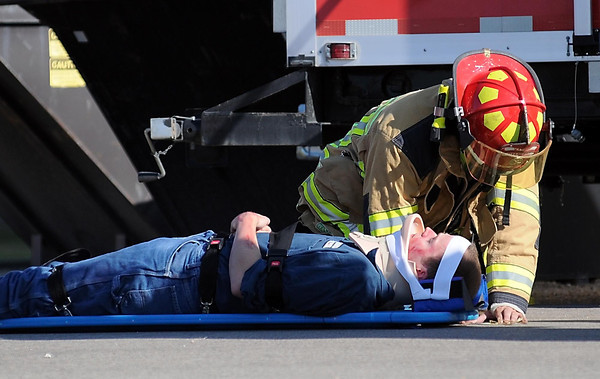 A Waseca firefighter checks on the condition of a simulated injured plant worker during a drill Saturday at the Guardian Energy ethanol plant in Janesville.