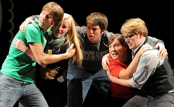 From left, Scott Fassett, Rachel Skaaland, Andrew Asp, Rae Gleason and Hank Heyer rehearse for this year's production of Theater Physics at Bethany Lutheran College.