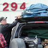 Pat Christman<br /> Peter and Pam Akins tie an ice fishing house on top of their truck after purchasing it at the Garden City Rod and Gun Club's Sportsman's Garage Sale Saturday in Lake Crystal.