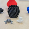 A few objects made from John Ruprecht's 3D printer were on display during the opening of the Strategic Partnership Center on Thursday. Ruprecht, a senior at Minnesota State, said he began a small startup company called Cubic 3D where he's printing everything from plastic business cards to parts for local businesses. Photo by Jackson Forderer