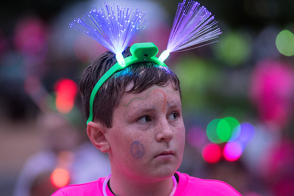David Reynolds, 11, has Type 1 diabetes and has gone to Camp Sweet Life for the past five years and ran in the 5K at the Glow in the Park event on Saturday at Sibley Park. Photo by Jackson Forderer