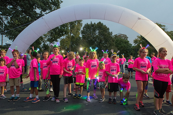Children line up for the start of the Kids K race at Sibley Park during the Camp Sweet Life Glow in the Park event. The event benefits a summer camp for children with Type 1 diabetes. Photo by Jackson Forderer