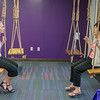 Minnesota State Professor Gloria Meng (right) and Kristin Scott talk while on the swings at the opening of the Strategic Partnership Center in the old Hubbard Building. The swings, on the second floor, were a big hit with those touring the renovated building. Photo by Jackson Forderer