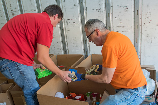 Mark Frederick (right) and Andy Miller sort through items donated for Hurricane Irma victims on Wednesday. The donation truck located outside of St. Peter and Paul's Church will close its doors tonight at 8 p.m. and is bound for Homosassa, Fla. Photo by Jackson Forderer