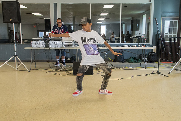 Octavian Boyd, 11, dances to hip hop music played by Austin Owen, who goes by DJ AO, at Revival Sessions 2, a hip hop celebration held in the Caledonia Community Center. Photo by Jackson Forderer