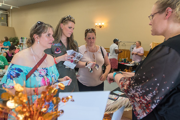 From left, Paige Swanson, Aletha Drenth and Nikki Thilges talk with Tricia Kvenvold of Color Street in the vendor room at the 9th annual Grape Stomp and Vendor Show held at Indian Island Winery on Saturday. Photo by Jackson Forderer