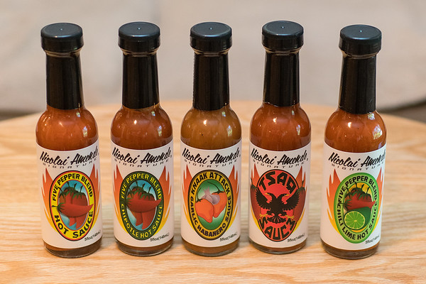 Five of Nicolai Amende's hot sauces, including his hottest sauce, the Knaak Attack in the middle.