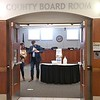 """First Congressional District candidate Dan Feehan puts on an """"I Voted"""" sticker as he, his wife Amy and their daughter Maeve leave the Nicollet County Board chambers after voting Friday. The chamber was converted to voting space in anticipation of accommodating more early voters than usual."""