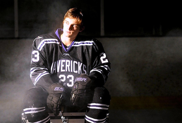 Minnesota State University men's hockey player Teddy Blueger watches as a video camera circles him during a shoot at the team's media day Thursday.
