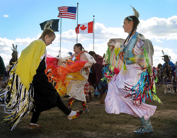 John Cross<br /> Young girls dance to the drummers this weekend at the 40th annual Mahkato Wacipi at Land of Memories Park.