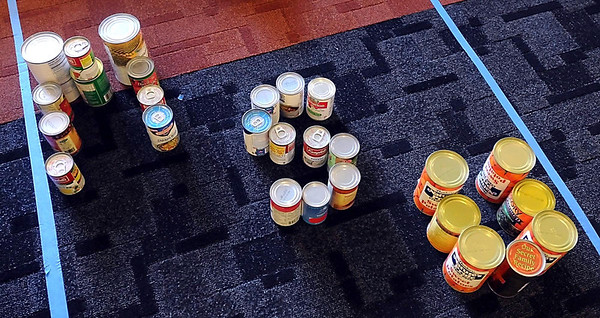 """""""MSU"""" spelled out in cans of donated food during Thursday's canned food sculpture contest."""