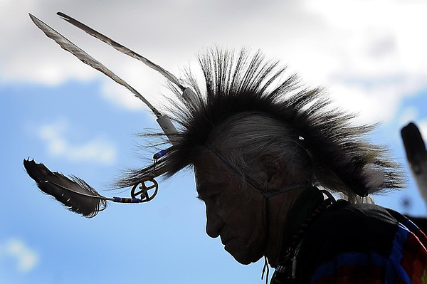 John Cross<br /> Head feathers sway as a dancer participates in the 40th annual Mahkato Wacipi at Land of Memories this weekend.