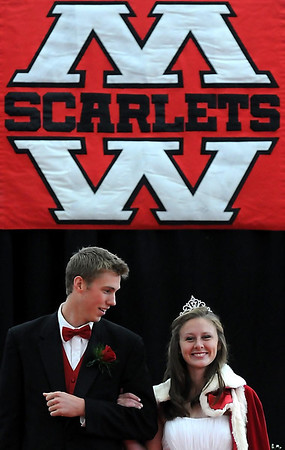 "Breeta Oxnard is all smiles Friday as she is escorted by Ian Schwickert after being crowned Mankato West Homecoming queen. To view photos of all of the queen candidates and their escorts, go to  <a href=""http://www.mankatofreepress.com"">http://www.mankatofreepress.com</a>."
