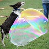 Pat Christman <br /> Casey Rose's dog Rufus could care less about the rain as he pounces at a soap bubble during the Arf Walk Saturday at Land of Memories Park.