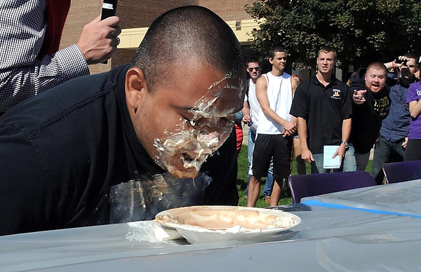 Pat Christman <br /> Erik Lopez finishes his sundae before his competitors during the finals of the macaroni and cheese and sundae eating contest Wednesday at MSU. It was his third consecutive victory in the contetst.