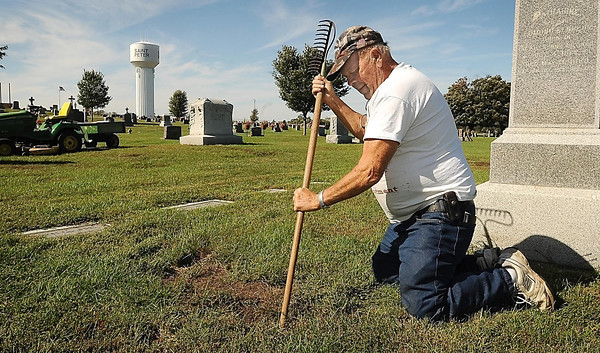 John Cross<br /> Tom Janni, caretaker at Calvary Cemetery in St. Peter, probes the depths of a hole left by marauding badgers. He estimates he has filled nearly two dozen of the holes left by the animals as they search for gophers over the last month.