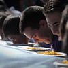 Pat Christman <br /> Competitors could only use their faces to finish a plate of macaroni and cheese as fast as possible.