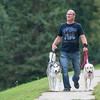 Kevin Fischer walks his dogs Mikko (left) and Ziva through Spring Lake Park on Tuesday. Photo by Jackson Forderer