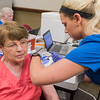 Levone Enevold gets a flu shot from Katie Hiller in the community room at River Hills Mall on Tuesday. Photo by Jackson Forderer