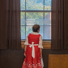 Carol Schaible, in a traditional dirndl dress, looks out the window during the monthly Deutsch-Amerikanisch Stammtisch meeting held at the old Loyola high school. The club is celebrating its 35th year in Mankato. Photo by Jackson Forderer