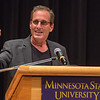 David Wellstone, the son of the late Sen. Paul Wellstone, gives a speech in Ostrander Auditorium on the campus of Minnesota State University on Tuesday. Wellstone said he thought about not giving the speech, less than two weeks after having a heart attack, but the issue of mental health was more important to him. Photo by Jackson Forderer