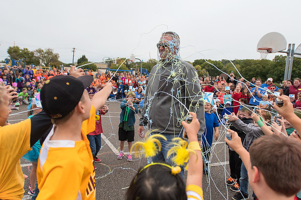 The top fundraiser from each class at Franklin Elementary School sprays silly string on their Principal Travis Olson at the end of a Walk-a-Thon held on Thursday. Olson said that the students raised $11,092 to be used to supplement school activities. Photo by Jackson Forderer