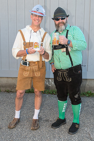 North Mankato Mayor Mark Dehen (left) and Patrick Johnston show off their lederhosen outfits while holding their Bier on Belgrade mugs at the event on Saturday. Dehn's mug is from the first Bier on Belgrade from 2012, which Johnston said he helped to produce. Photo by Jackson Forderer