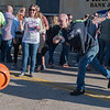 Bret Bauer (right) throws a small orange keg in a game of keg bowling at Bier on Belgrade on Saturday. Bauer would later describe the origins of keg bowling from Luxembourg, a small country south of Germany. Photo by Jackson Forderer