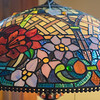 "A detail of one of the many stained-glass lamps in Henderson Classical Glass. Customer Claudia Miller said ""I love coming to Henderson. Every time we (she and her sister from Florida) get together we come here."" Owner Dee Thomas said 20 percent of her customers are local and 80 percent are from the metro area. Photo by Jackson Forderer"